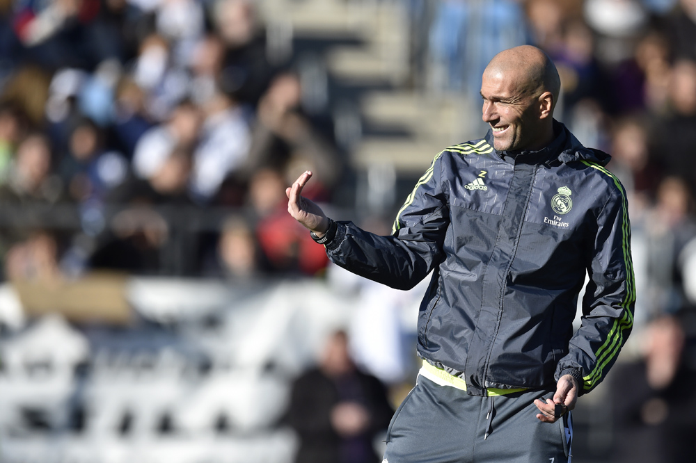 """Real Madrid's new French coach Zinedine Zidane gestures during his first training session as coach of Real Madrid at the Alfredo di Stefano stadium in Valdebebas, on the outskirts of Madrid, on January 5, 2016. Real Madrid legend Zinedine Zidane promised to put his """"heart and soul"""" into managing the Spanish giants after he was sensationally named as coach following Rafael Benitez's unceremonious sacking. AFP PHOTO/ GERARD JULIEN / AFP / GERARD JULIEN"""