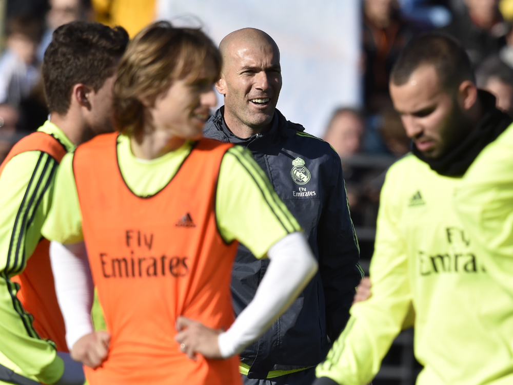 """Real Madrid's new French coach Zinedine Zidane looks on during his first training session as coach of Real Madrid at the Alfredo di Stefano stadium in Valdebebas, on the outskirts of Madrid, on January 5, 2016. Real Madrid legend Zinedine Zidane promised to put his """"heart and soul"""" into managing the Spanish giants after he was sensationally named as coach following Rafael Benitez's unceremonious sacking. AFP PHOTO/ GERARD JULIEN / AFP / GERARD JULIEN"""
