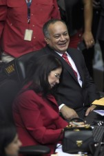 Diosdado Cabello (back), outgoing president of the National Assembly and Venezuela's first lady, Cilia Flores talk at the parliament in Caracas, on January 5, 2016. Venezuela's President Nicolas Maduro ordered the security forces to ensure the swearing-in of a new opposition-dominated legislature passes off peacefully Tuesday, after calls for rallies raised fears of unrest. AFP PHOTO/JUAN BARRETO / AFP / JUAN BARRETO
