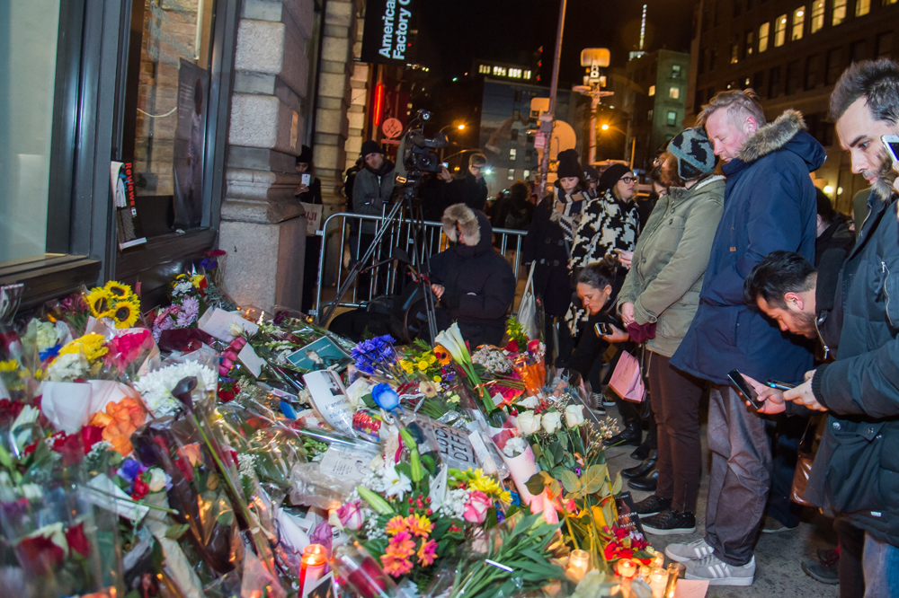 NEW YORK, NY - JANUARY 11: David Bowie is remembered by fans who gathered outside his home in SoHo on January 11, 2016 in New York, United States. Bowie passed away at on Sunday, January 10th at the age on 69 after an 18 month battle with cancer. Mark Sagliocco/Getty Images/AFP
