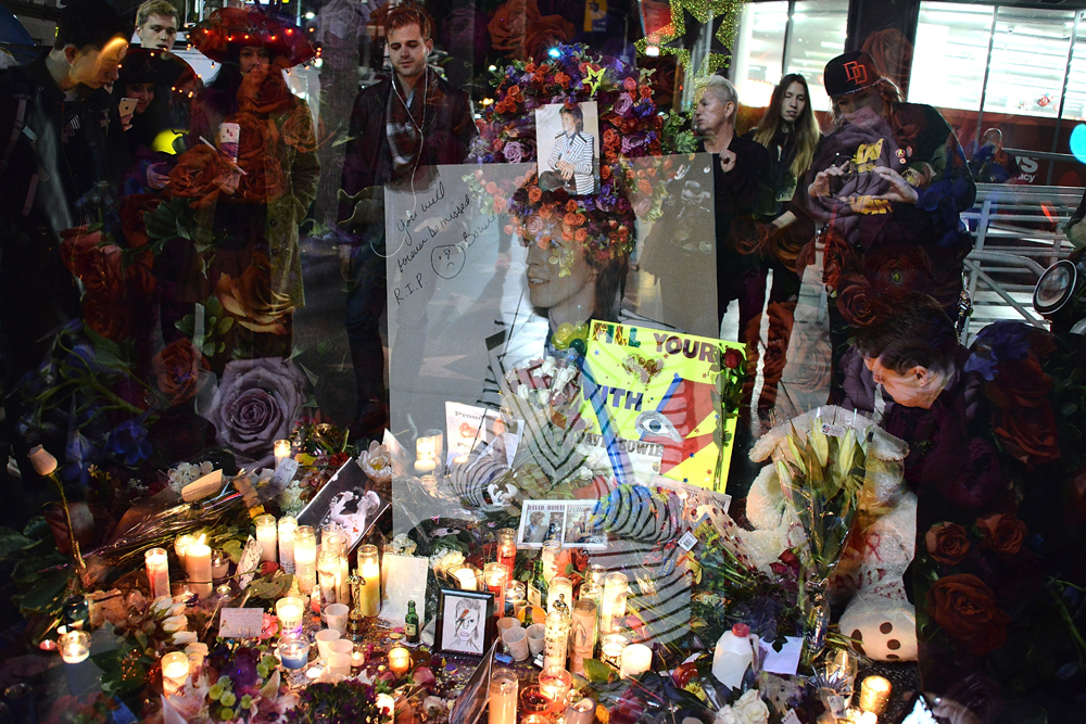 HOLLYWOOD, CA - JANUARY 11: (EDITORS NOTE: Image was created using multiple exposure in camera) David Bowie remembered on The Hollywood Walk of Fame on January 11, 2016 in Hollywood, California. Araya Diaz/Getty Images/AFP