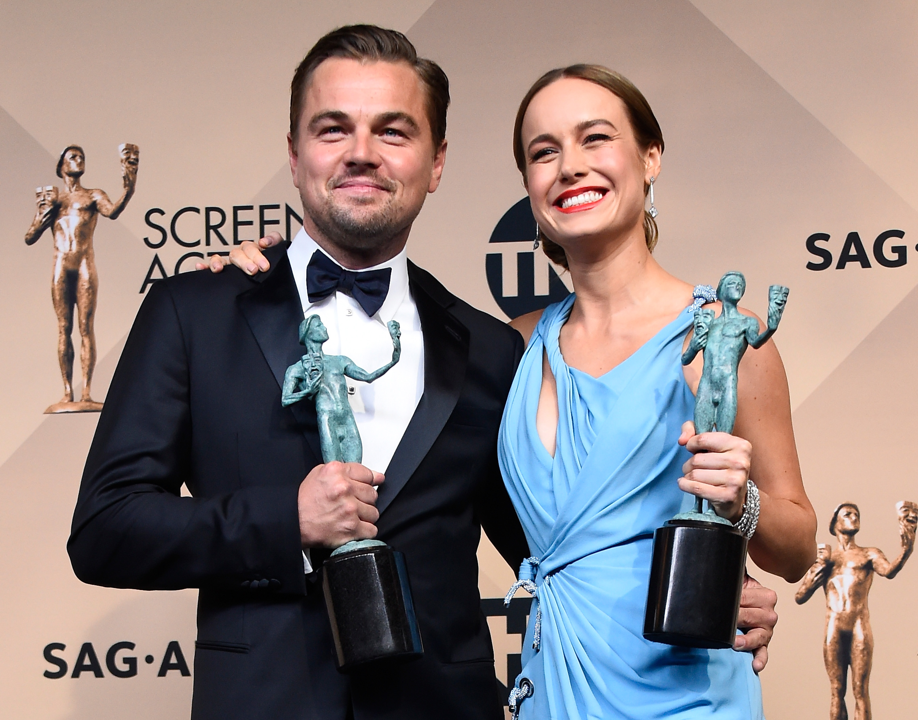 LOS ANGELES, CA - JANUARY 30: Actors Leonardo DiCaprio (L), winner of Outstanding Performance By a Male Actor in a Leading Role for 'The Revenant,' and Brie Larson winner of Outstanding Performance By a Female Actor in a Leading Role for 'The Room,' pose in the press room during the 22nd Annual Screen Actors Guild Awards at The Shrine Auditorium on January 30, 2016 in Los Angeles, California. Frazer Harrison/Getty Images/AFP