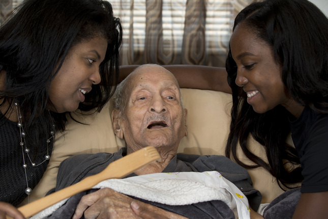 "Andrew Hatch, who will celebrate his 117th birthday on Wednesday, poses for a photograph with his daughter Delane Sims, left, and granddaughter SherriAnn Cole, at his Oakland, Calif. home, Tuesday, Oct. 6, 2015. Hatch, who was born in 1898, when William McKinley was President of the 45 United States, will be feted by his family with a ""backscratching"" birthday party. (D. Ross Cameron/Bay Area News Group)"