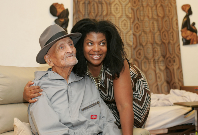 Andrew Hatch of Oakland, who celebrated his 116th birthday on Tuesday, poses for a picture with his daughter Delane Sims, 53, on Tuesday Oct. 7, 2014. (Doug Oakley/Bay Area News Group)