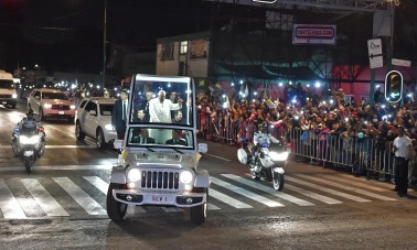 Pope Francis waves from the Popemobile upon his arrival in Mexico City on February 12, 2016. Catholic faithful flocked to the streets of Mexico City to greet Pope Francis on Friday after the pontiff held a historic meeting with the head of the Russian Orthodox Church in Cuba. AFP PHOTO/Yuri Cortez / AFP / YURI CORTEZ