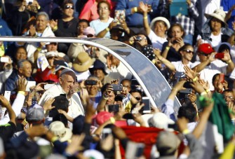 "Pope Francis waves at the crowd from the popemobile on his way to the Guadalupe Basilica in Mexico City on February 13, 2016. Pope Francis urged Mexican bishops Saturday to take on drug trafficking with ""prophetic courage,"" warning that it represents a moral challenge to society and the church. AFP PHOTO / Pedro PARDO / AFP / Pedro PARDO"