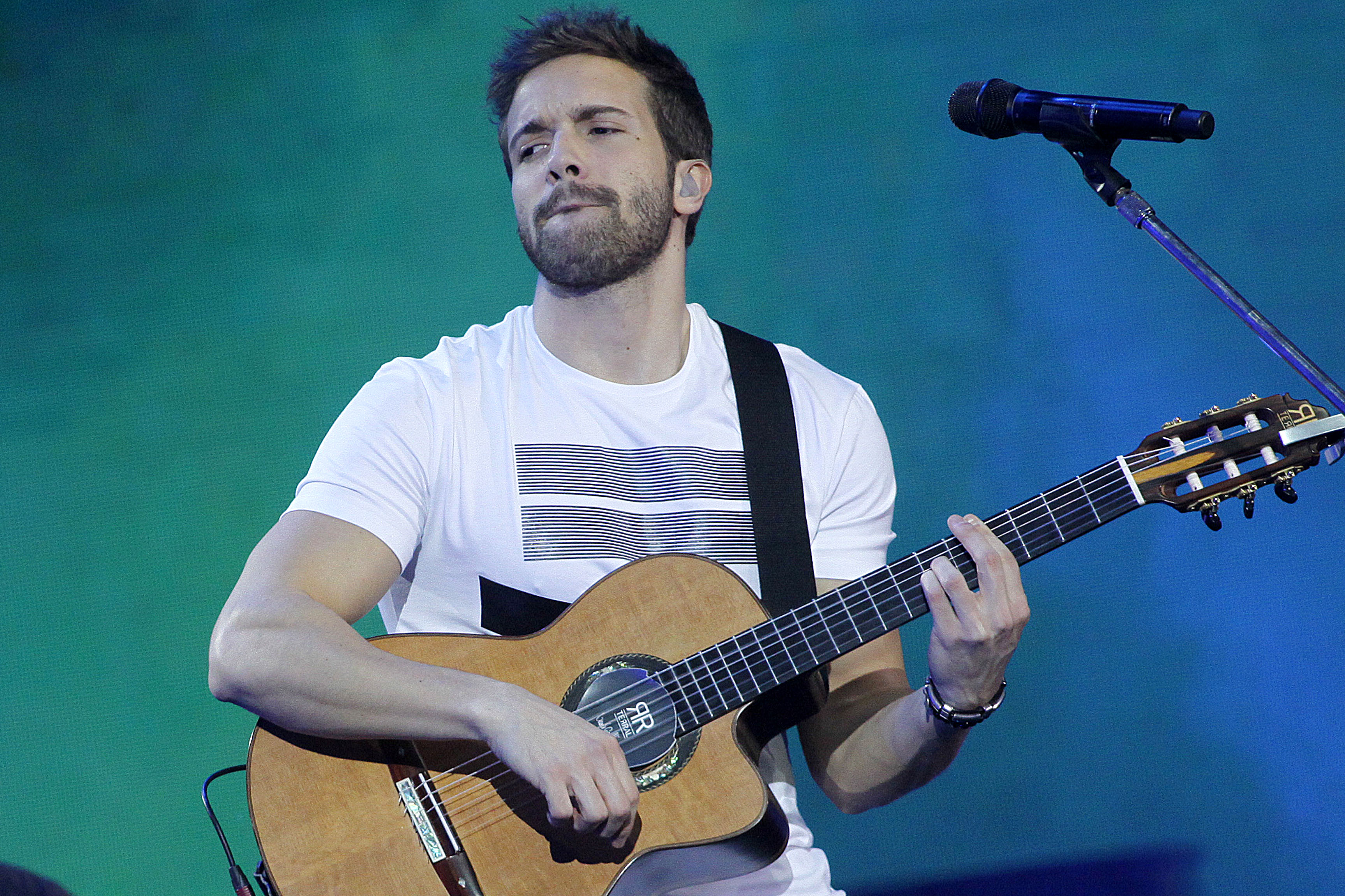 Spanish singer Pablo Alboran performs during Vina del Mar song Festival in Vina del Mar, Chile on February 26, 2016. AFP PHOTO / Aton Chile - Luis G. CollaO / AFP / ATON CHILE / LUIS G. COLLAO