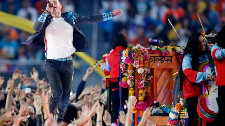 SANTA CLARA, CA - FEBRUARY 07: Chris Martin of Coldplay performs during the Pepsi Super Bowl 50 Halftime Show at Levi's Stadium on February 7, 2016 in Santa Clara, California.   Sean M. Haffey/Getty Images/AFP