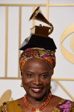 "Angelique Kidjo poses with her Best World Music Album trophy for ""Sings"" in the press room during the 58th Annual Grammy Music Awards in Los Angeles on February 15, 2016. AFP PHOTO / MARK RALSTON / AFP / MARK RALSTON"