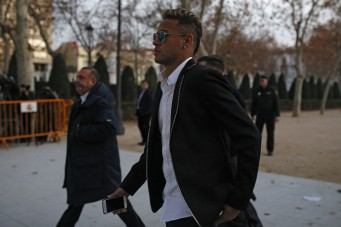 FC Barcelona's Neymar leaves the national court after testifying at an investigation into alleged irregularities regarding his transfer to Barcelona, in Madrid, Tuesday, Feb. 2, 2016. The court is looking into a complaint made by a Brazilian investment group which claims it was financially harmed when Barcelona and Neymar allegedly withheld the real amount of the player's transfer fee from Brazilian club Santos in 2013. (AP Photo/Francisco Seco)