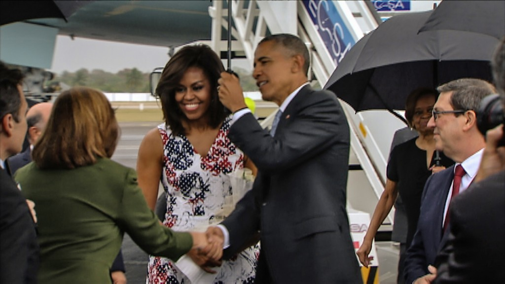 Video grab from Cuban TV of US President Barack Obama (C) next to First Lady Michelle Obama as they are greeted by the Director General of the U.S. division at Cuba's Foreign Ministry Josefina Vidal (L) upon their arrival at Jose Marti international airport in Havana on March 20, 2016, on a historic three-day visit to the communist-ruled island.  Barack Obama on Sunday became the first US president in 88 years to visit Cuba, touching down in Havana for a landmark trip aimed at ending decades of Cold War animosity. AFP PHOTO / CUBAN TV / AFP / CUBAN TV / --