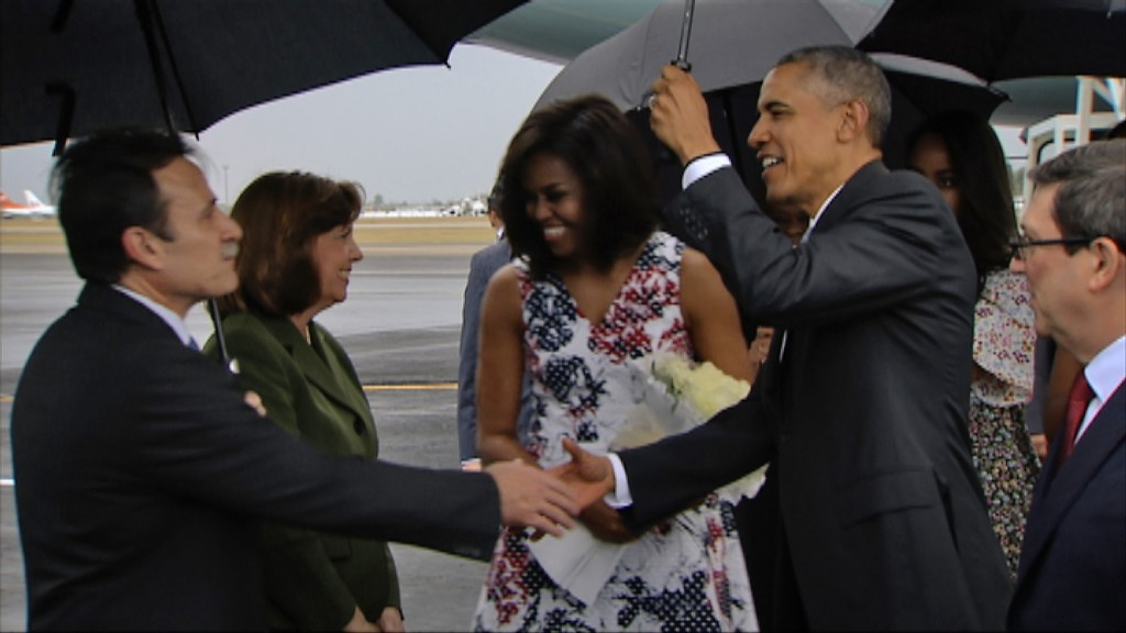 Video grab from Cuban TV of US President Barack Obama (2nd-R) next to first Lady Michelle Obama (C), greeted by Deputy Director for American Affairs in Cuba's Foreign Ministry, Gustavo Machin Gomez (L), next to Cuban Foreign Minister Bruno Rodriguez (R) and the head of the U.S. division at the Cuban Foreign Ministry, Josefina Vidal (2nd-L), upon the Obamas' arrival at Jose Marti international airport in Havana on March 20, 2016. Barack Obama on Sunday became the first US president in 88 years to visit Cuba, touching down in Havana for a landmark trip aimed at ending decades of Cold War animosity. AFP PHOTO / CUBAN TV / AFP / CUBAN TV / --