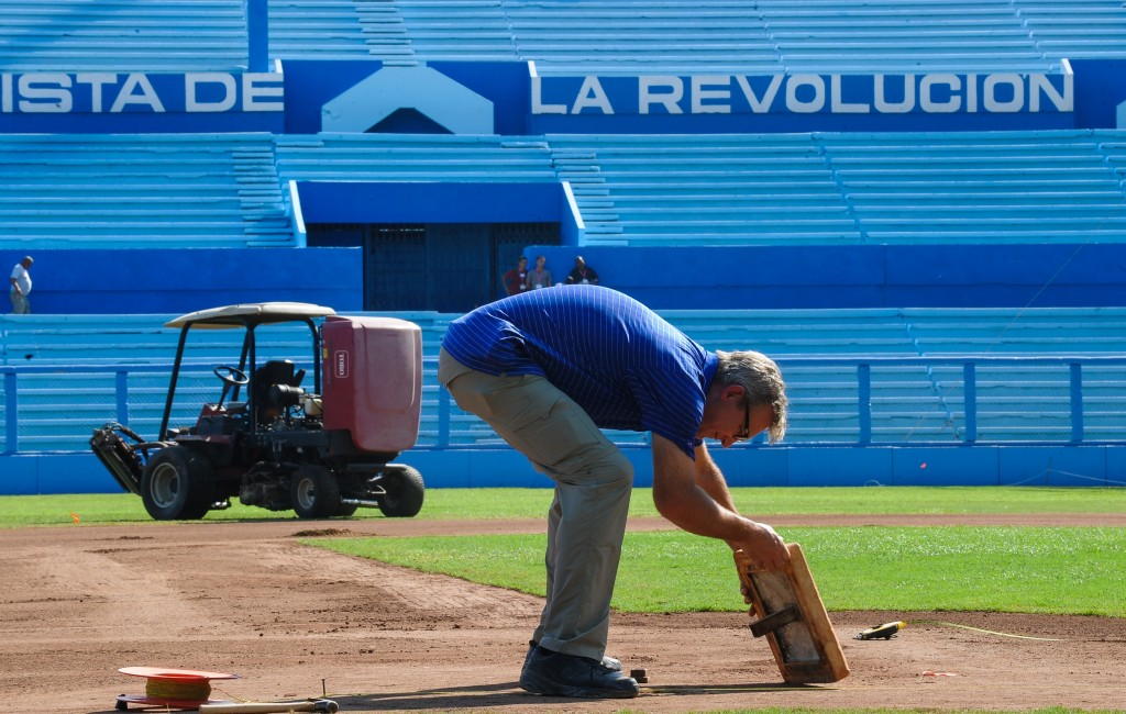 A man takes part in repair works of the Latinoamericano stadium in Havana, on March 13, 2016. Cubans look forward to the baseball game between the US Tampa Bay Rays team and the Cuban team, which will take place on March 22, with the presence of US President Barack Obama.     AFP PHOTO/ YAMIL LAGE / AFP / YAMIL LAGE