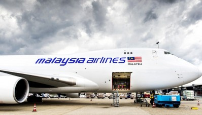A plane carrying coffins with the remains of victims of Malaysian Airlines flight MH17 sits on the tarmac at Schiphol International Airport in Amsterdam before flying to Malaysia on August 21, 2014. Malaysia will drape itself in black for a national day of mourning on August 22 as it welcomes home the first remains of its 43 citizens killed in the MH17 disaster. The MH17 plane was shot down over rebel-held eastern Ukraine on July 17 en route from Amsterdam to Kuala Lumpur, with the west blaming Russian-backed separatists, while Moscow blames Ukraine. AFP PHOTO / ANP / KOEN VAN WEEL == NETHERLANDS OUT ==