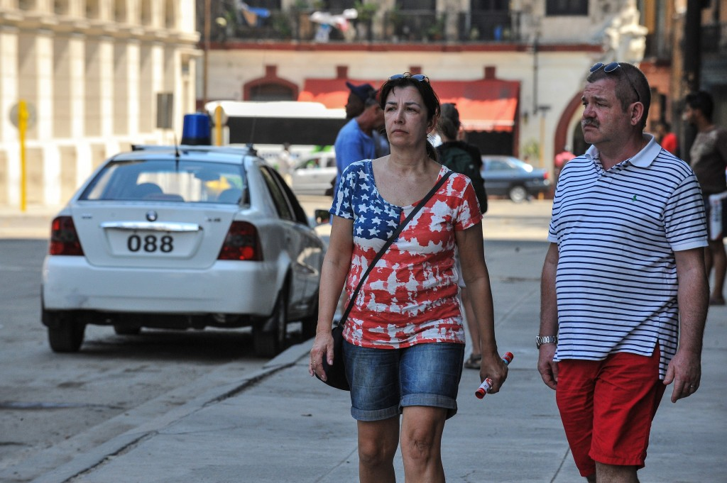 A woman wearing clothes in the colours of the US flag walks in Havana on March 17, 2016. Hundreds of workers have been scrambling for days to touch up building facades, patch potholes and spiff up Havana's monuments ahead of US President Barack Obama's visit. Obama next week will become the first US president to visit Cuba while in office in almost a century. AFP PHOTO/YAMIL LAGE / AFP / YAMIL LAGE