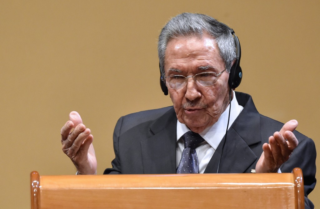 """Cuban President Raul Castro gestures as he delivers a joint press conference with US President Barack Obama (out of frame) after a meeting at the Revolution Palace in Havana on March 21, 2016. Cuba's Communist President Raul Castro on Monday stood next to Barack Obama and hailed his opposition to a long-standing economic """"blockade,"""" but said it would need to end before ties are fully normalized.   AFP PHOTO/Nicholas KAMM / AFP / NICHOLAS KAMM"""