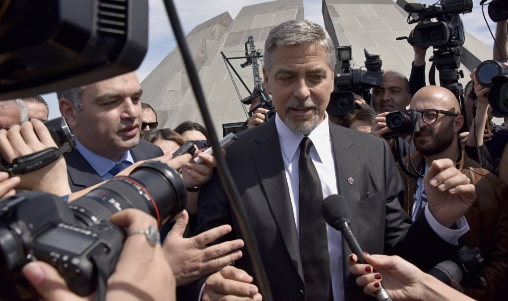 US actor George Clooney talks to media in Yerevan at the Genocide Memorial on April 24, 2016. Hollywood star and rights advocate George Clooney led thousands of Armenians on a march to a hilltop memorial in Yerevan to commemorate the 101st anniversary of the WW I-era Armenian genocide in the Ottoman Empire. / AFP PHOTO / KAREN MINASYAN