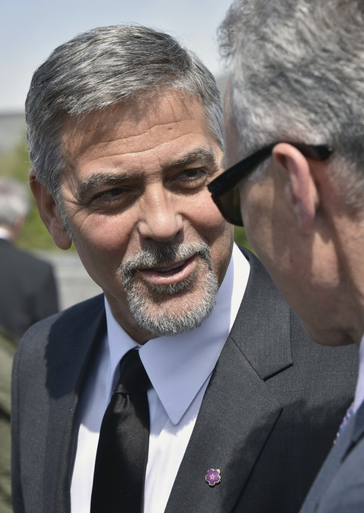 US actor George Clooney attends a ceremony at the Armenian Genocide Memorial in Yerevan on April 24, 2016. Hollywood star and rights advocate George Clooney led thousands of Armenians on a march to a hilltop memorial in Yerevan to commemorate the 101st anniversary of the WW I-era Armenian genocide in the Ottoman Empire. / AFP PHOTO / KAREN MINASYAN