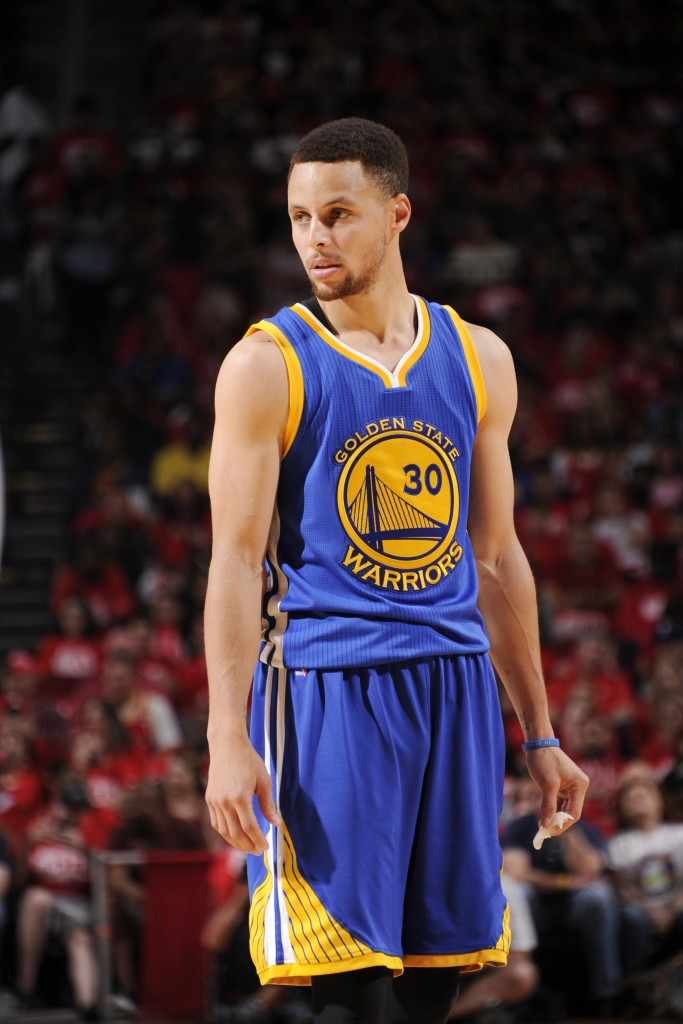 HOUSTON, TX - APRIL 24: Stephen Curry #30 of the Golden State Warriors stands on the court during the game against the Houston Rockets in Game Four of the Western Conference Quarterfinals during the 2016 NBA Playoffs on April 24, 2016 at the Toyota Center in Houston, Texas. NOTE TO USER: User expressly acknowledges and agrees that, by downloading and or using this photograph, User is consenting to the terms and conditions of the Getty Images License Agreement. Mandatory Copyright Notice: Copyright 2016 NBAE   Bill Baptist/NBAE via Getty Images/AFP
