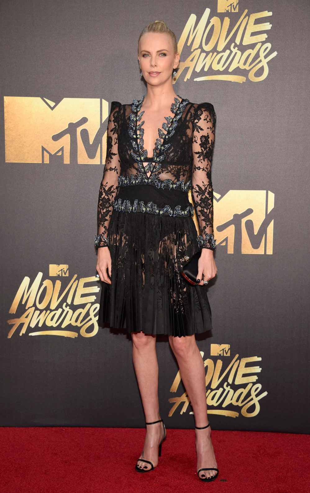 Actress Charlize Theron arrives at the 2016 MTV Movie Awards in Burbank, California April 9, 2016. REUTERS/Phil McCarten