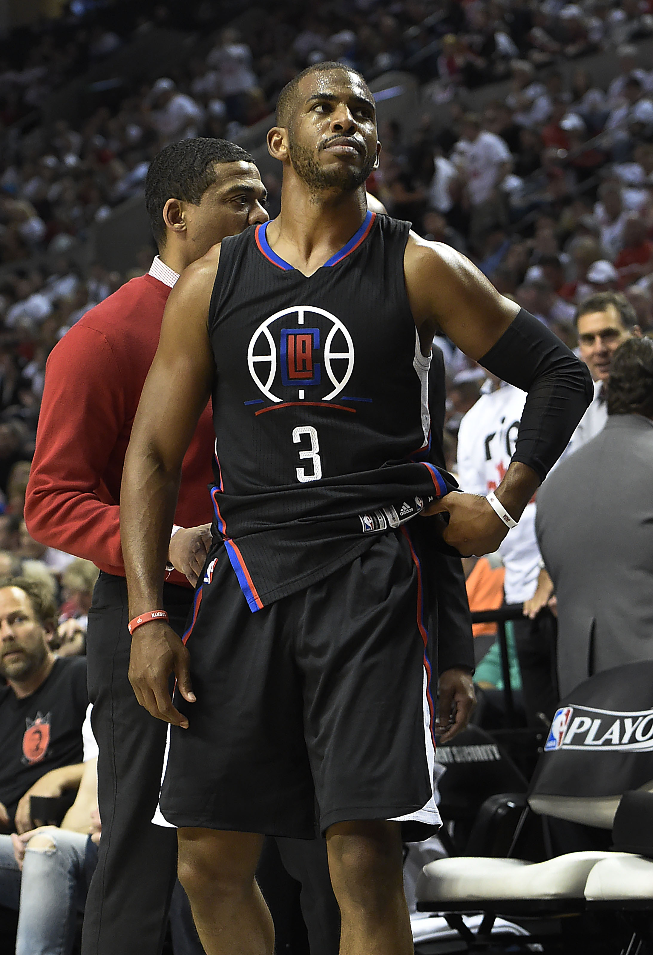 PORTLAND, OR - APRIL 25: Chris Paul #3 of the Los Angeles Clippers walks off the court after he injured his hand in the third quarter of Game Four of the Western Conference Quarterfinals against the Portland Trail Blazers during the 2016 NBA Playoffs at the Moda Center on April 25, 2016 in Portland, Oregon. The Blazers won the game 98-84. NOTE TO USER: User expressly acknowledges and agrees that by downloading and/or using this photograph, user is consenting to the terms and conditions of the Getty Images License Agreement.   Steve Dykes/Getty Images/AFP