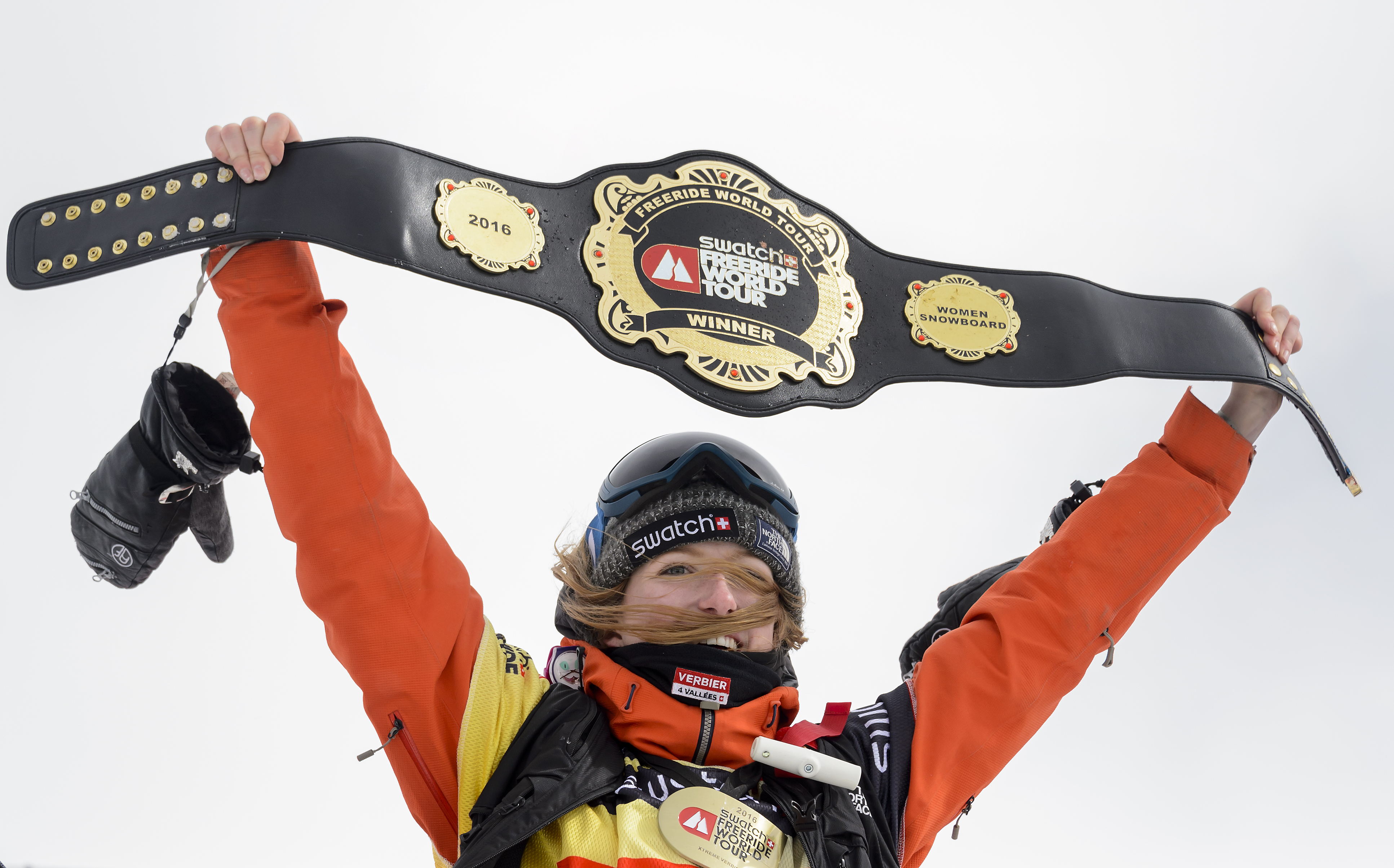 (FILES) This file photo taken on April 02, 2016 shows World champion Switzerland's Estelle Balet waving with the overall belt after she won the women's snowboard event at the Bec des Rosses during the Verbier Xtreme Freeride World Tour final above the Swiss Alps resort of Verbier.  An avalanche in the Swiss Alps on April 19, 2016 swept away two-time world extreme snowboard champion Estelle Balet to her death, police said. The 21-year-old Swiss woman, who had won her second title on the Freeride World Tour only two weeks ago, was making a film when she was killed, Swiss police said in a statement. Balet was speeding down a slope on her snowboard when the avalanche started and carried her away, police added.  / AFP PHOTO / FABRICE COFFRINI