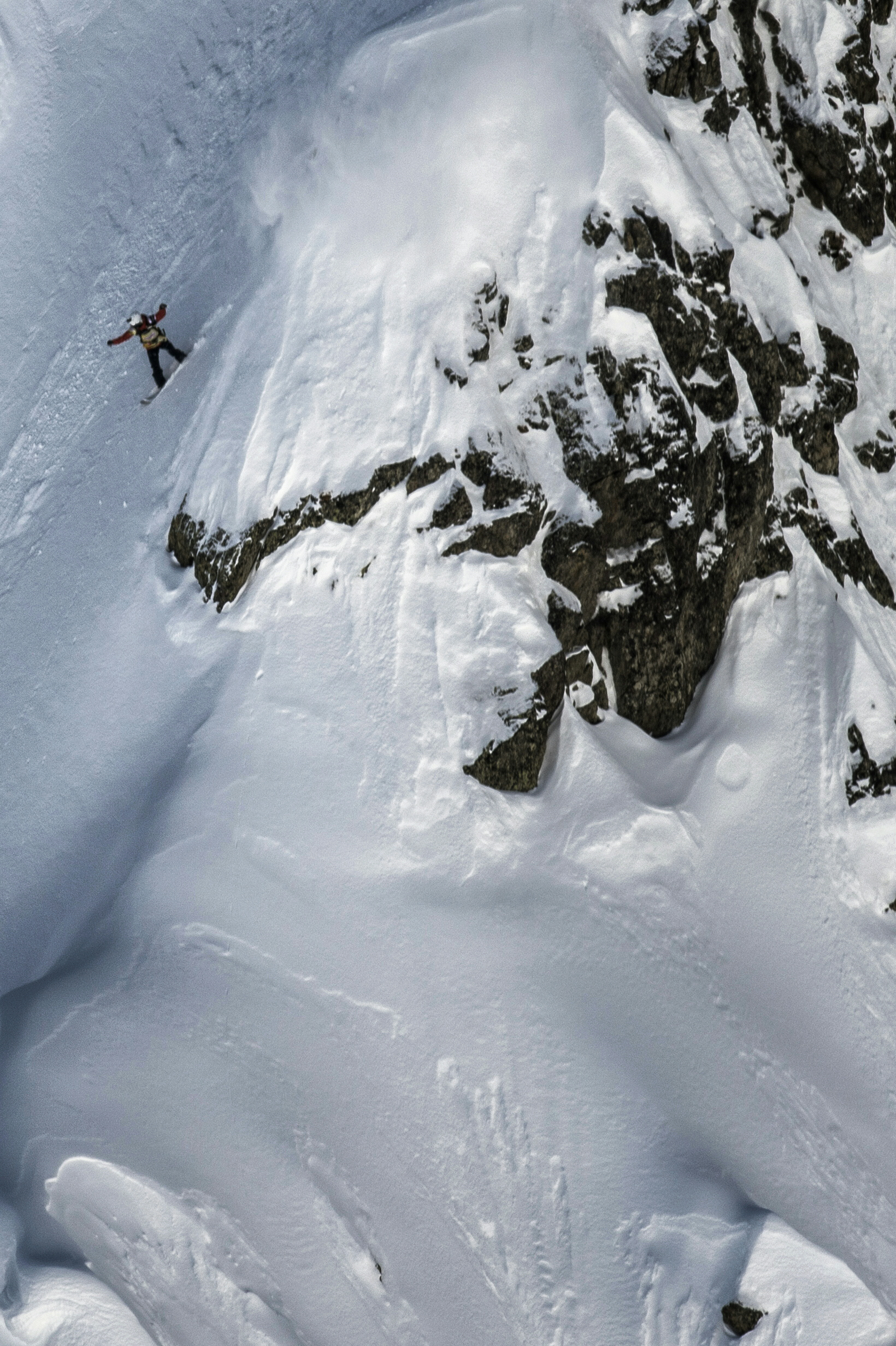 """A picture taken on February 5, 2016 shows France's Estelle Balet competing to win the wild face of """"l'Aiguille Pourrie"""" during a stage of the Swatch Freeride World Tour in Chamonix. An avalanche in the Swiss Alps on April 19, 2016 swept away two-time world extreme snowboard champion Estelle Balet to her death, police said. The 21-year-old Swiss woman, who had won her second title on the Freeride World Tour only two weeks ago, was making a film when she was killed, Swiss police said in a statement. Balet was speeding down a slope on her snowboard when the avalanche started and carried her away, police added. / AFP PHOTO / JEFF PACHOUD"""