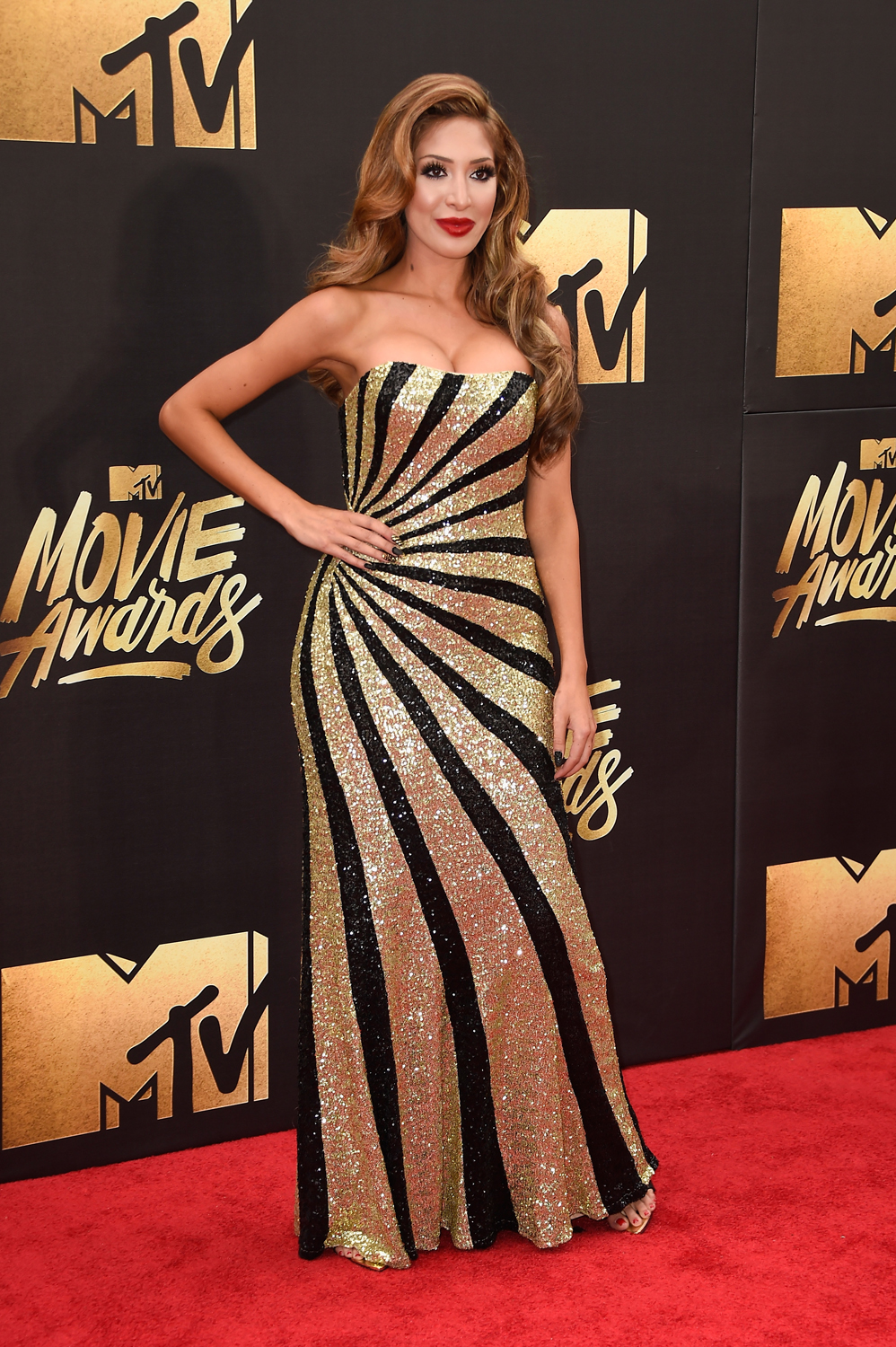 BURBANK, CALIFORNIA - APRIL 09: TV personality Farrah Abraham attends the 2016 MTV Movie Awards at Warner Bros. Studios on April 9, 2016 in Burbank, California. MTV Movie Awards airs April 10, 2016 at 8pm ET/PT. Frazer Harrison/Getty Images/AFP