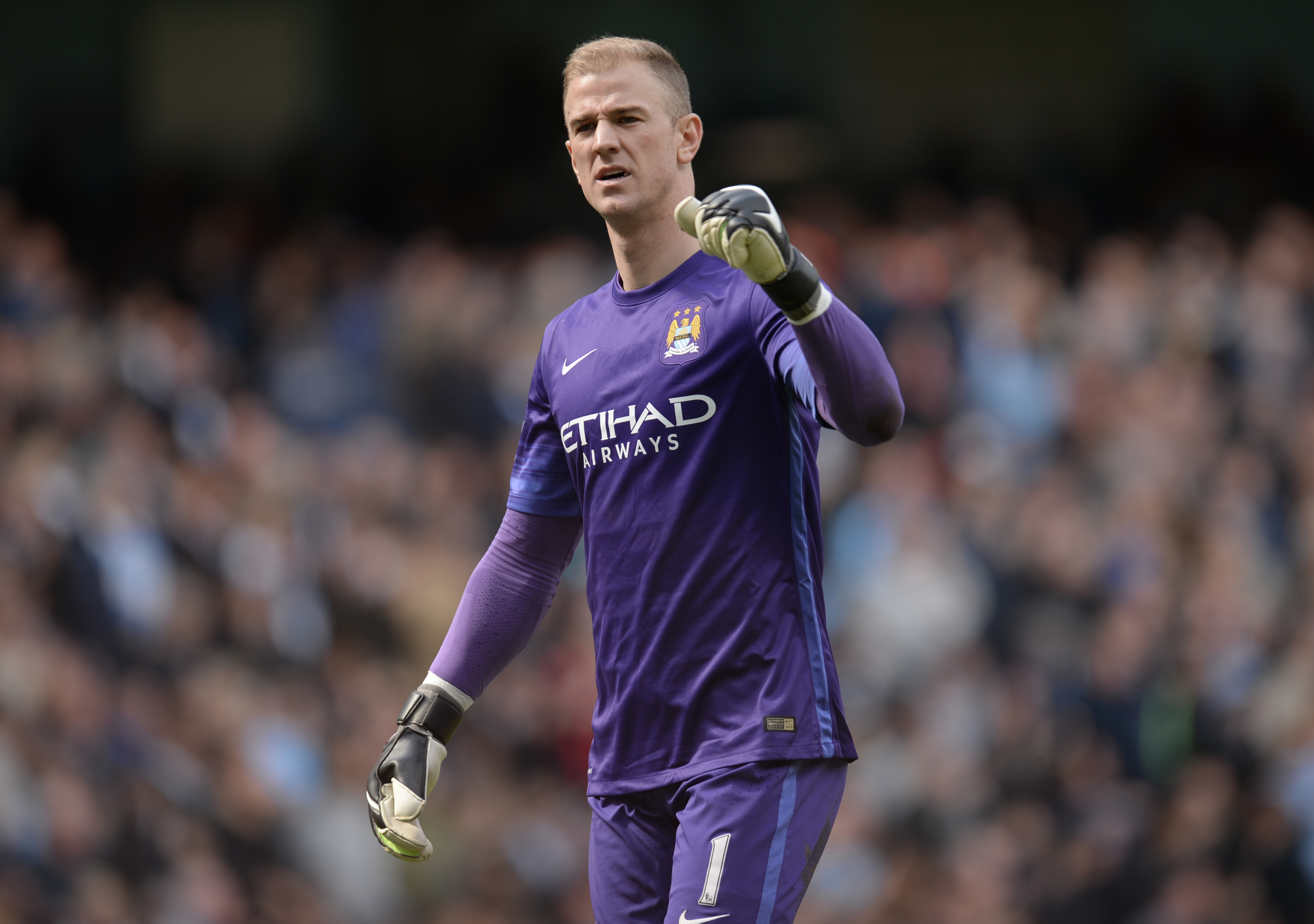 Manchester City's English goalkeeper Joe Hart celebrates after City score their third goal during the English Premier League football match between Manchester City and Stoke City at the Etihad Stadium in Manchester, north west England, on April 23, 2016. / AFP PHOTO / OLI SCARFF / RESTRICTED TO EDITORIAL USE. No use with unauthorized audio, video, data, fixture lists, club/league logos or 'live' services. Online in-match use limited to 75 images, no video emulation. No use in betting, games or single club/league/player publications.  /