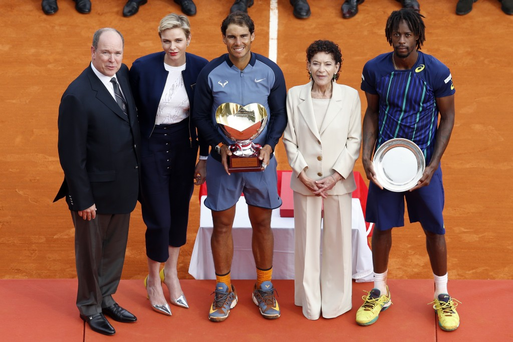 (LtoR) Prince Albert II of Monaco, Princess Charlene of Monaco, Spain's Rafael Nadal, Elisabeth Anne de Massy and France's Gael Monfils pose after the final tennis match at the Monte-Carlo ATP Masters Series Tournament in Monaco on April 17, 2016. Nadal defeated Monfils 7-5, 5-7, 6-0 to win a record ninth title at the Monte Carlo Masters.  AFP PHOTO / VALERY HACHE / AFP PHOTO / VALERY HACHE