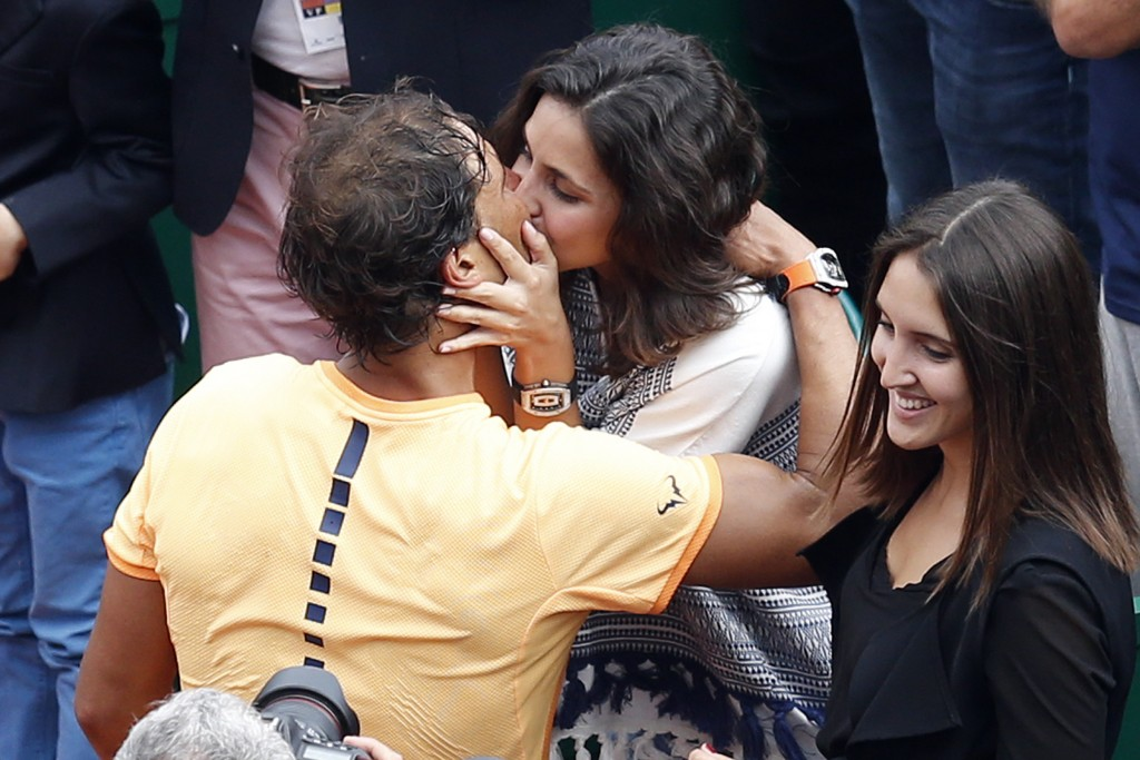 Spain's Rafael Nadal kisses his girlfriend Xisca Perello after winning against France's Gael Monfils in the final tennis match at the Monte-Carlo ATP Masters Series Tournament in Monaco on April 17, 2016. Nadal defeated Monfils 7-5, 5-7, 6-0 to win a record ninth title at the Monte Carlo Masters.  AFP PHOTO / VALERY HACHE / AFP PHOTO / VALERY HACHE