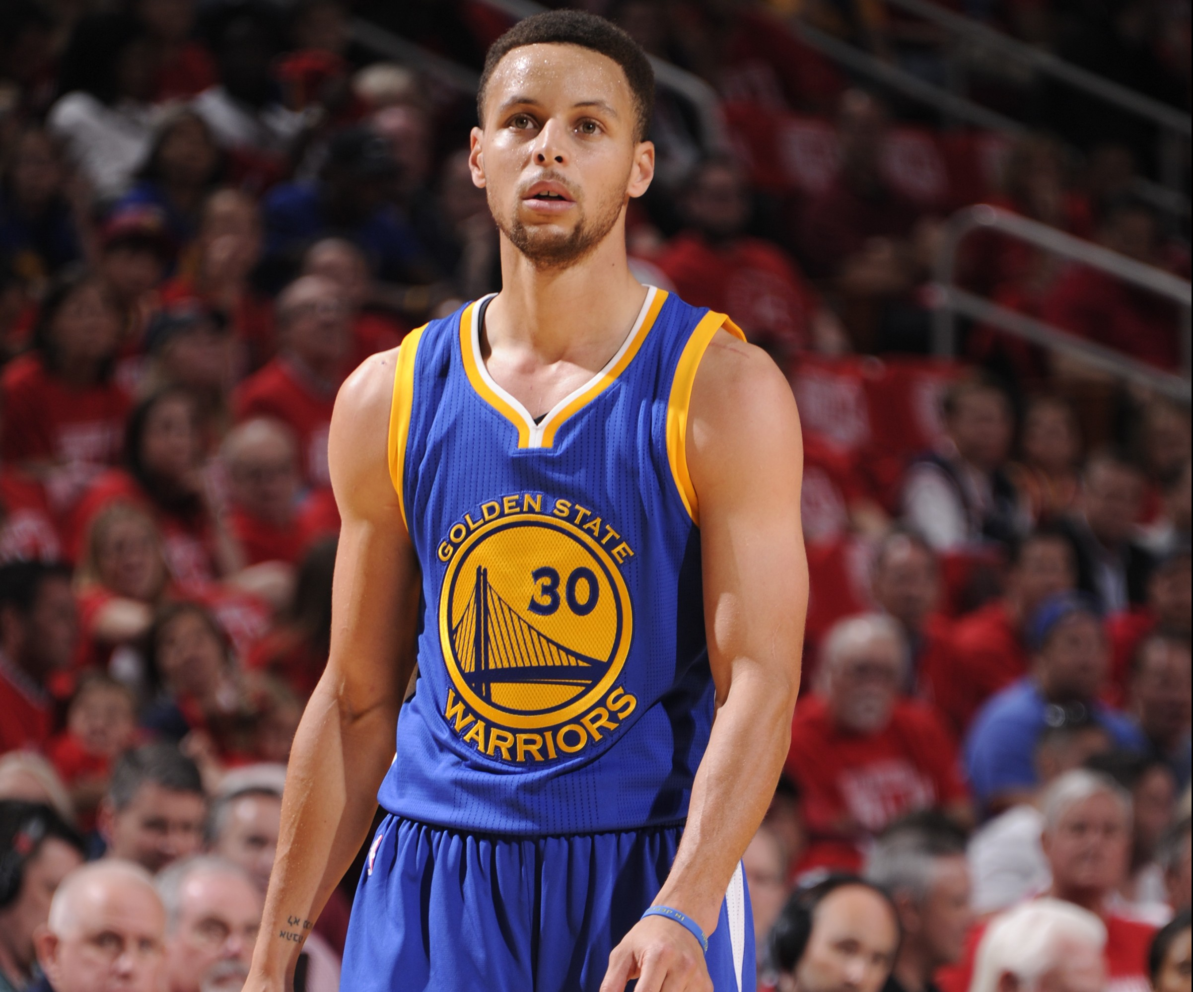 HOUSTON, TX - APRIL 24: Stephen Curry #30 of the Golden State Warriors stands on the court against the Houston Rockets in Game Four of the Western Conference Quarterfinals during the 2016 NBA Playoffs on April 24, 2016 at the Toyota Center in Houston, Texas. NOTE TO USER: User expressly acknowledges and agrees that, by downloading and or using this photograph, User is consenting to the terms and conditions of the Getty Images License Agreement. Mandatory Copyright Notice: Copyright 2016 NBAE   Bill Baptist/NBAE via Getty Images/AFP