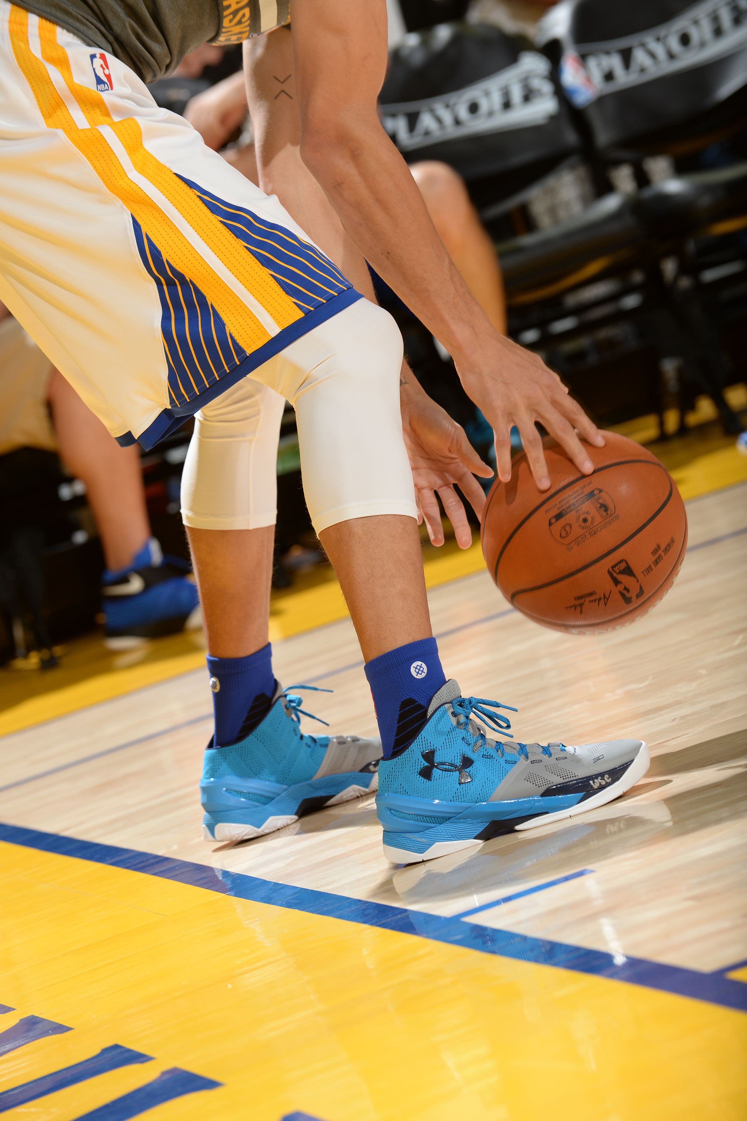 OAKLAND, CA - APRIL 18: The sneakers of Stephen Curry #30 of the Golden State Warriors before the game against the Houston Rockets in Game Two of the Western Conference Quarterfinals during the 2016 NBA Playoffs on April 18, 2016 at ORACLE Arena in Oakland, California. NOTE TO USER: User expressly acknowledges and agrees that, by downloading and or using this photograph, user is consenting to the terms and conditions of Getty Images License Agreement. Mandatory Copyright Notice: Copyright 2016 NBAE   Noah Graham/NBAE via Getty Images/AFP