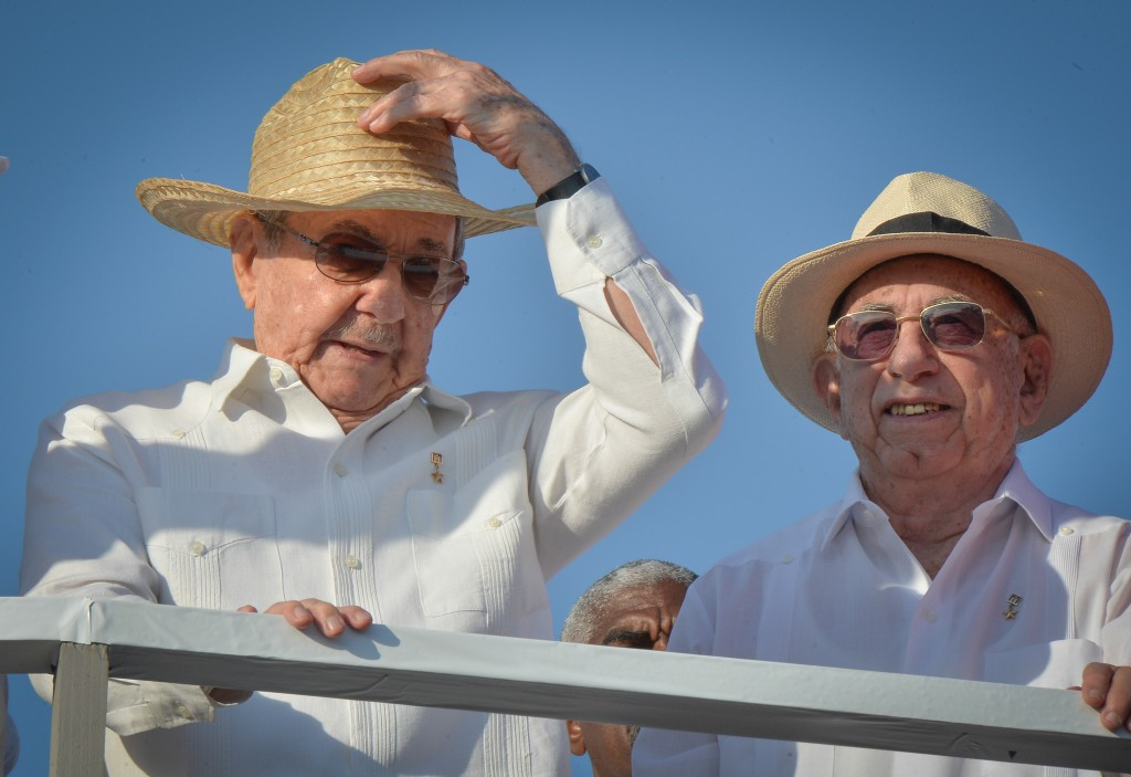 Cuban President Raul Castro (L) and Vice-President Jose Ramon Machado Ventura attend the May Day parade at Revolution Square in Havana, on May 1, 2016. / AFP PHOTO / ADALBERTO ROQUE