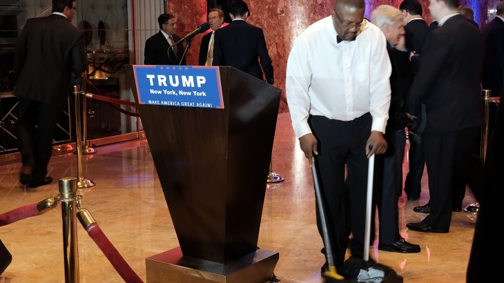 NEW YORK, NY - APRIL 26: A worker at Trump Towers cleans the floor moments before the Republican presidential candidate makes his way to the podium to speak to supporters and the media at Trump Towers following the conclusion of primaries Tuesday in northeastern states on April 26, 2016 in New York, New York. Trump again gained more delegates to move him closer to the Republican presidential nomination.   Spencer Platt/Getty Images/AFP