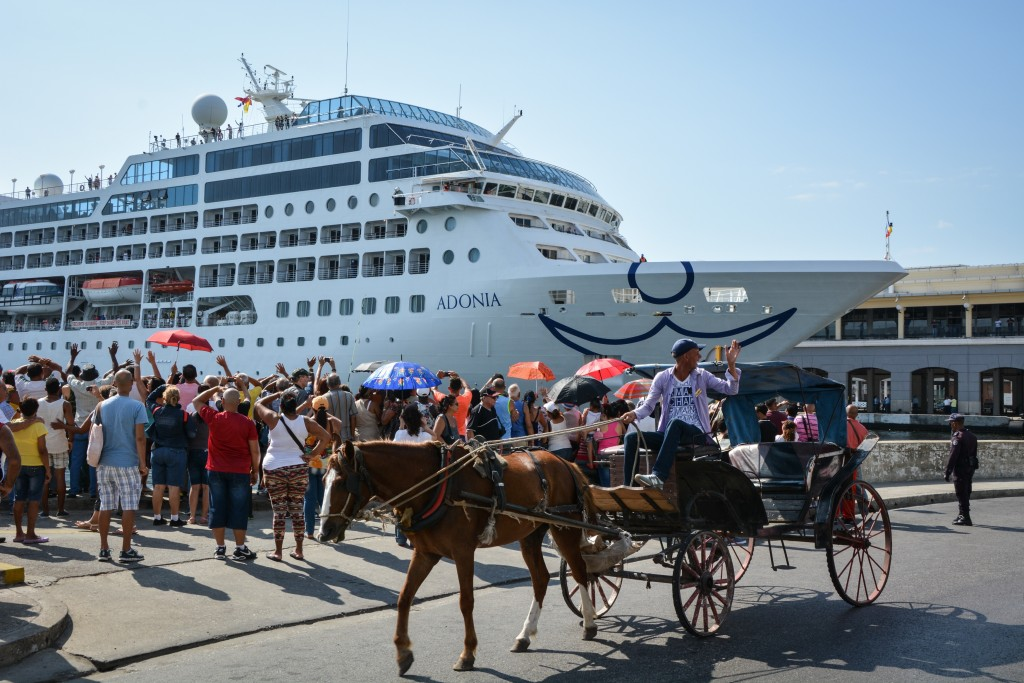 The first US-to-Cuba cruise ship to arrive in the island nation in decades remains docked at the port of Havana, on May 2, 2016.  The first US cruise ship bound for Cuba in half a century, the Adonia -- a vessel from the Carnival cruise's Fathom line -- set sail from Florida on Sunday, marking a new milestone in the rapprochement between Washington and Havana. The ship -- with 700 passengers aboard -- departed from Miami, the heart of the Cuban diaspora in the United States. / AFP PHOTO / JORGE BELTRAN