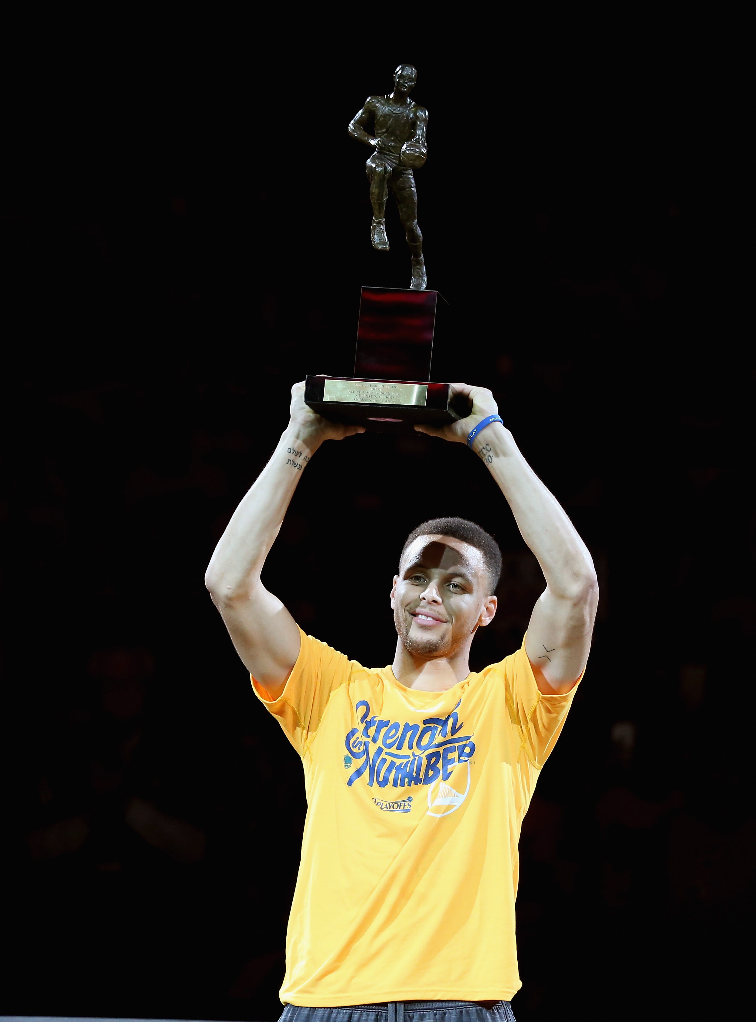 OAKLAND, CA - MAY 11: Stephen Curry #30 of the Golden State Warriors lifts up his MVP trophy before their game against the Portland Trail Blazers in Game Five of the Western Conference Semifinals during the 2016 NBA Playoffs on May 11, 2016 at Oracle Arena in Oakland, California. NOTE TO USER: User expressly acknowledges and agrees that, by downloading and or using this photograph, User is consenting to the terms and conditions of the Getty Images License Agreement.   Ezra Shaw/Getty Images/AFP
