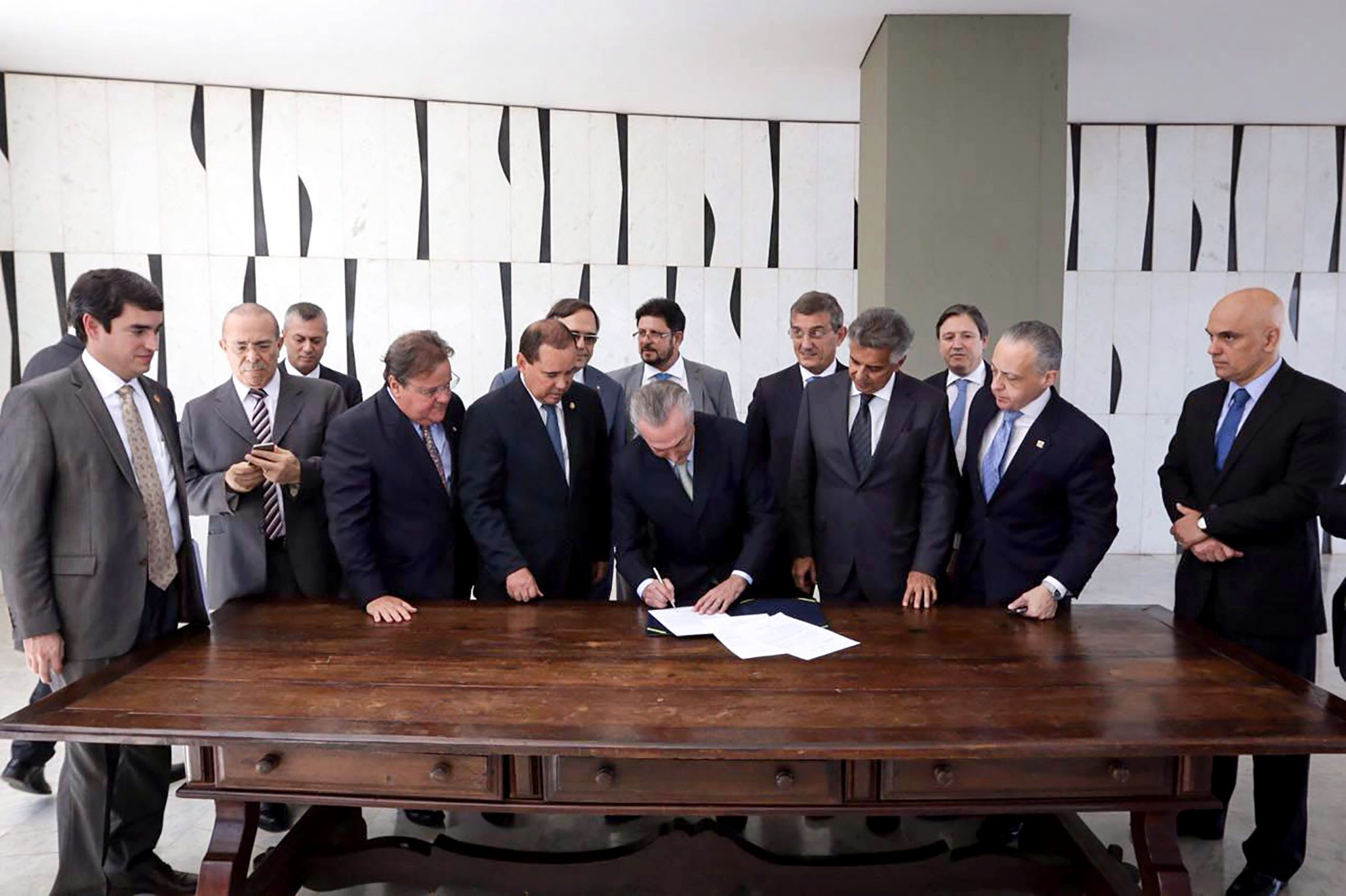 Brazilian acting President Michel Temer assumes as interim president at Jaburu Palace after the withdrawal of President Dilma Rousseff by the Senate in Brasilia on May 12, 2016. Temer, a center-right veteran with the backing of the markets, named former central bank chief Henrique Meirelles -- a champion of orthodox monetary policies -- as finance minister and former Sao Paulo governor Jose Serra as foreign minister, an adviser told AFP. / AFP PHOTO / Brazilian Vice Presidency / MARCOS CORREA / BEST QUALITY AVAILABLE