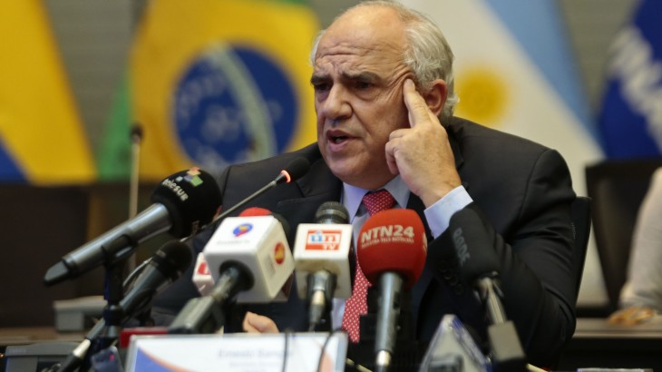 "UNASUR Secretary General Ernesto Samper speaks about the political crisis in Brazil, during a press conference in Quito on May 12, 2016. Brazilian suspended President Dilma Rousseff urged Brazilians to ""mobilize"" against what she branded a ""coup"" to drive her from power after senators voted to launch an impeachment trial against her. / AFP PHOTO / JUAN CEVALLOS"