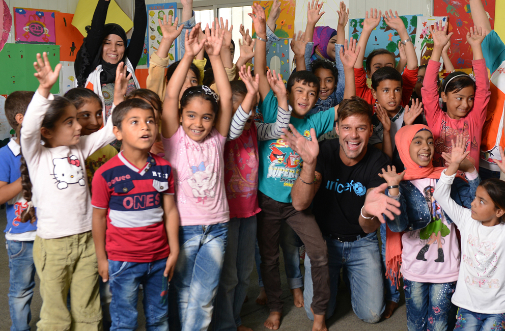 On 1 June 2016, UNICEF goodwill ambassador Ricky Martin with Syrian refugee children at a UNICEF supported safe space for children in Tal Hayat in northern Lebanon. Around 60 children from the nearby informal settlement for refugees participate in daily Psycho-social support activities. . UNICEF is currently working in 576 intervention sites to deliver child protection interventions across the country. World-renowned singer and UNICEF Goodwill Ambassador Ricky Martin calls for increased focus on safeguarding the futures of millions of children affected by the Syria conflict, whose lives have been shaped by displacement, violence and a persistent lack of opportunities. Around 1.1 million Syrians have sought refuge in Lebanon since the start of the crisis in 2011, more than half of them are children. Child refugees are particularly at risk of exploitation and abuse, with large numbers being left with no choice but to go out to work, rather than attend school.  The deteriorating economic situation for Syrian refugees has dramatically exacerbated the problem of child labour in Lebanon. Adding to the psychological distress already affecting many of the children who have fled conflict and violence at home is the challenge associated with some of the worst forms child labour such as working on construction sites, which can cause long-term developmental and psychological damage as well as physical harm.  During the two-day visit on 1-2 June 2016, Martin also witnessed how UNICEF is working to provide protective environments for children and adolescents where they can play and receive the support they need to get back into formal education. In Lebanon's Bekaa valley and Akkar, Martin participated in recreational activities for children at safe spaces in informal settlements. Additionally, he met adolescents attending life-skills training, provided by UNICEF and partners, where girls and boys are given vocational training and learning support.