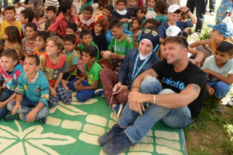 On 2 June 2016, UNICEF goodwill ambassador Ricky Martin watches a puppet show about good hygiene practices with Syrian refugee children from the Rmoul informal settlement in northern Lebanon. Around 139 refugees live in the Rmoul settlement, more than half of them children under 18. UNICEF, with its partners, provides a comprehensive package of water, sanitation and hygiene promotion package for Rmoul and more than 1,360 other locations. Including the provision of adequate water supplies, latrines, and hygiene promotion activities.  World-renowned singer and UNICEF Goodwill Ambassador Ricky Martin calls for increased focus on safeguarding the futures of millions of children affected by the Syria conflict, whose lives have been shaped by displacement, violence and a persistent lack of opportunities. Around 1.1 million Syrians have sought refuge in Lebanon since the start of the crisis in 2011, more than half of them are children. Child refugees are particularly at risk of exploitation and abuse, with large numbers being left with no choice but to go out to work, rather than attend school.  The deteriorating economic situation for Syrian refugees has dramatically exacerbated the problem of child labour in Lebanon. Adding to the psychological distress already affecting many of the children who have fled conflict and violence at home is the challenge associated with some of the worst forms child labour such as working on construction sites, which can cause long-term developmental and psychological damage as well as physical harm.  During the two-day visit on 1-2 June 2016, Martin also witnessed how UNICEF is working to provide protective environments for children and adolescents where they can play and receive the support they need to get back into formal education. In Lebanon's Bekaa valley and Akkar, Martin participated in recreational activities for children at safe spaces in informal settlements. Additionally, he met adolescents attending life-skills training, prov