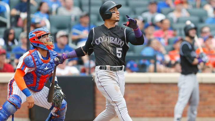 NEW YORK, NY - JULY 31: Carlos Gonzalez #5 of the Colorado Rockies follows through on a seventh inning run scoring sacrifice fly against the New York Mets at Citi Field on July 31, 2016 in the Flushing neighborhood of the Queens borough of New York City.   Jim McIsaac/Getty Images/AFP