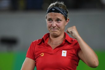 Belgium's Kirsten Flipkens reacts after winning her women's first round singles tennis match against USA's Venus Williams at the Olympic Tennis Centre of the Rio 2016 Olympic Games in Rio de Janeiro on August 6, 2016. / AFP PHOTO / Luis Acosta