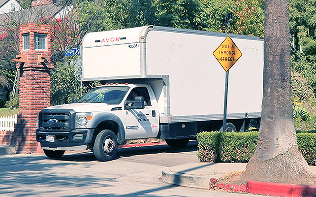Photo © 2016 INF/The Grosby Group Los Angeles, September 21, 2016 A Enterprise moving truck gets a Police escort at Brad and Angelina's house as reporters get video, after Angelina Jolie files for divorce from Brad Pitt.