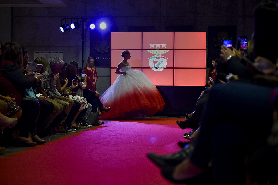 A model wears a creation by designer Micaela Oliveira during a presentation by Portuguese football club Benfica of 24 wedding dresses, 12 evening dresses and four dresses for girls at the Stadium of Light in Lisbon. Heavily indebted Portuguese giants Benfica unveiled tonight its first-ever collection of wedding dresses which it will sell alongside other club items such as jerseys, baby diapers and dog beds. / AFP PHOTO / PATRICIA DE MELO MOREIRA