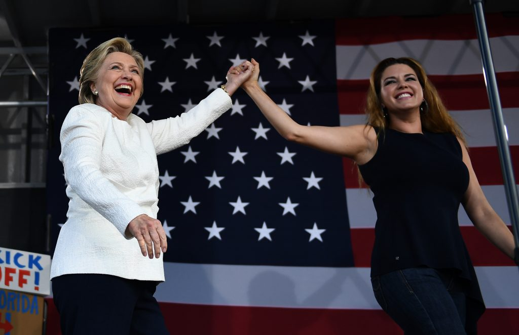 US Democratic presidential nominee Hillary Clinton and former Miss Universe Alicia Machado wave during a campaign rally at the Pasco-Hernando State College in Dade City, Florida, on November 1, 2016. FBI agents are plumbing hundreds of thousands of emails in search of potentially incriminating evidence against Democratic nominee Hillary Clinton, in a high pressure probe seven days before the US presidential election. What will come out of it and when is not known, but the impact of the FBI's bombshell discovery of a new trove of Clinton emails is already reverberating in the neck-and-neck race for the White House. / AFP PHOTO / JEWEL SAMAD