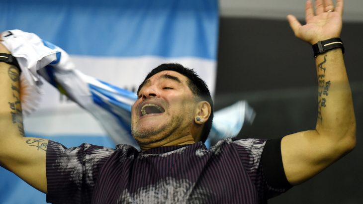Retired Argentinian professional footballer Diego Armando Maradona reacts during the Davis Cup World Group final doubles match between Croatia and Argentina at Arena hall in Zagreb on November 26, 2016. / AFP PHOTO / -