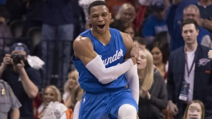 OKLAHOMA CITY, OK - DECEMBER 25: Oklahoma City Thunder guard Russell Westbrook #0 reacts after the Thunder scored against the Minnesota Timberwolves during the second half of a NBA game at the Chesapeake Energy Arena on December 25, 2016 in Oklahoma City, Oklahoma. The Thunder defeated the Timberwolves 112-100. NOTE TO USER: User expressly acknowledges and agrees that, by downloading and or using this photograph, User is consenting to the terms and conditions of the Getty Images License Agreement.   J Pat Carter/Getty Images/AFP